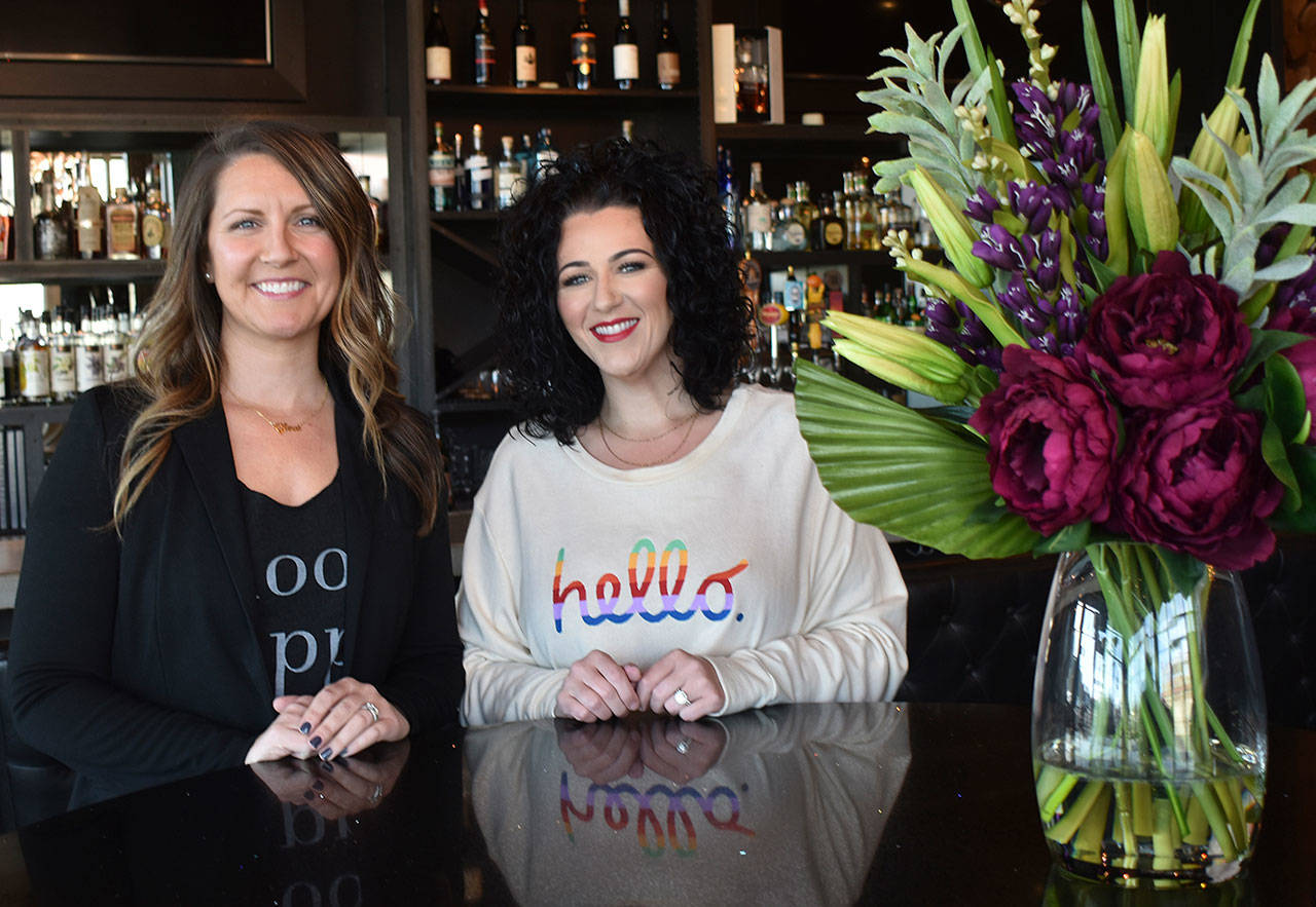 Leading the way at Glow Martini Lounge are sisters-friends-business partners Randi Baker (left) and Kendra Harrington. Photo by Kevin Hanson