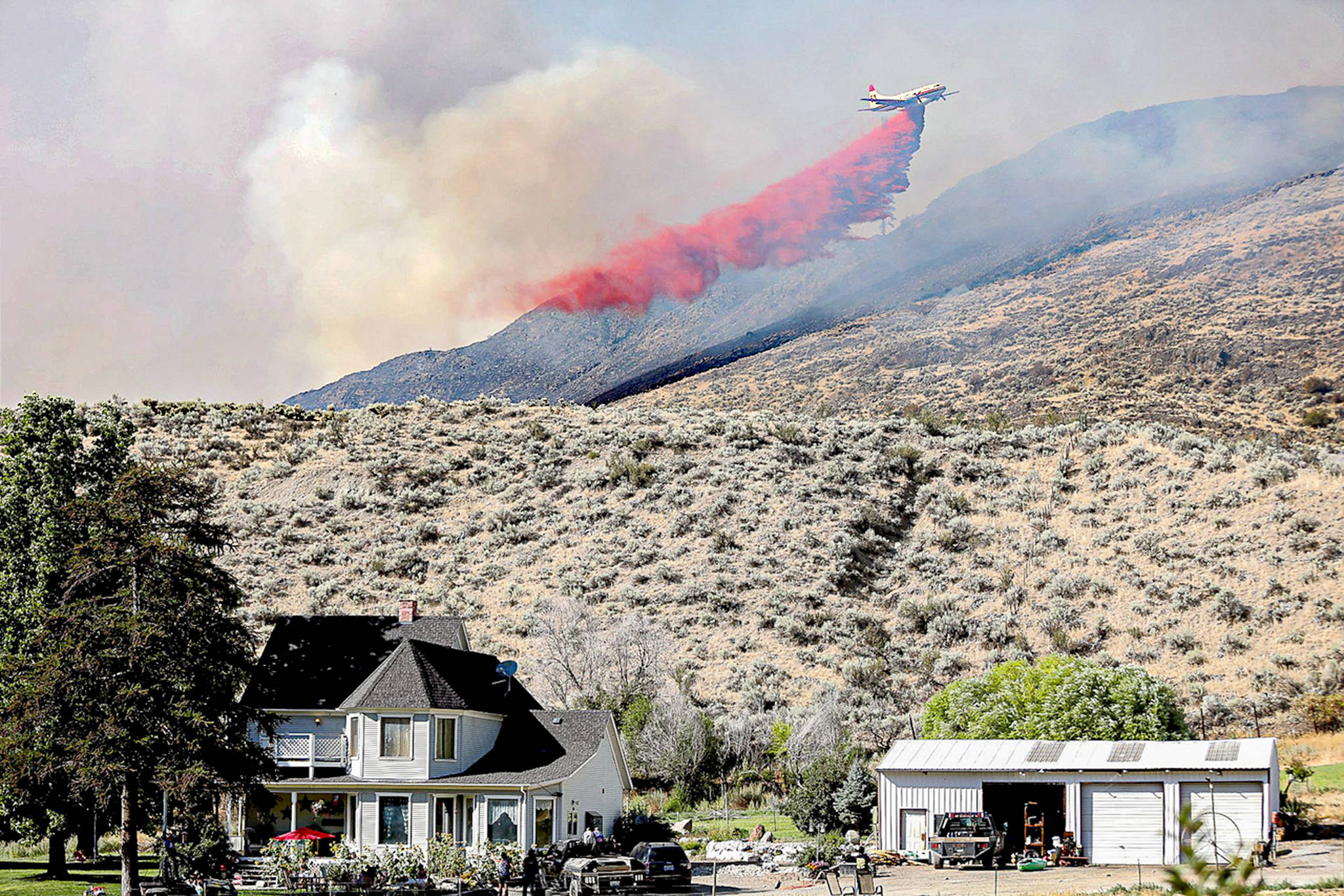 A plane drops fire retardant on the Palmer Mountain Fire last summer in north-central Washington. Laura Knowlton/Sound Publishing staff photo